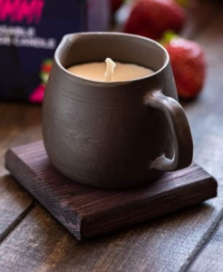 Massage candle in black pottery creamer photo review